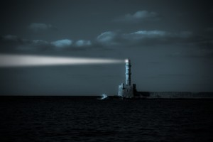 Image of lighthouse providing guidance in the darkness