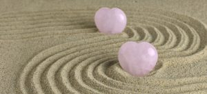Pink hearts in sand